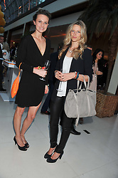 Left to right, BRYONY DANIELS and OLIVIA HUNT at the Veuve Clicquot Experience at The Hurlingham Party following the Polo in The Park held at the Hurlingham Club, London SW6 on 8th June 2012.