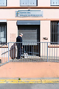 postman delivering mail to the closed tax office during the Covid 19 crisis and lockdown France Limoux April 2020
