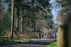 Peloton approach across the cobbles - Ronde van Drenthe 2016, a 138km road race starting and finishing in Hoogeveen, on March 12, 2016 in Drenthe, Netherlands.