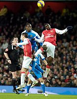 Photo: Ed Godden/Sportsbeat Images.<br /> Arsenal v Wigan Athletic. The Barclays Premiership. 11/02/2007. Wigan's Emile Heskey (centre), gets to the ball first.