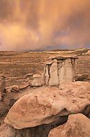 Sunset storm and hoodoos at Bisti Badlands, Bisti/De-Na-Zin Wilderness, New Mexico