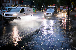 © Licensed to London News Pictures. 21/10/2021. London, UK. Surface water on the Euston road in North London caused by heavy rain over night in the capital. Flash flooding hit parts of the south east as Storm Aurore brought winds of up to 45mph . Photo credit: Ben Cawthra/LNP