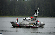 Coast Guard on the Siuslaw, checking boat for safety