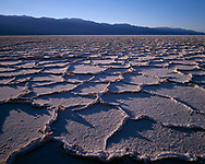 CADDV_005 - USA, California, Death Valley National Park, Polygonal patterns in salt pan on floor of Death Valley and the distant Panamint Mountains.