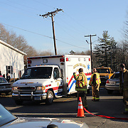 Ambulances leave the scene near the fire Station near  Sandy Hook after today's shootings at Sandy Hook Elementary School, Newtown, Connecticut, USA. 14th December 2012. Photo Tim Clayton