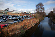 Car par or parking lot near the Digbeth Branch Canal in Digbeth on 13th Febuary 2020 in Birmingham, United Kingdom. In the city, vehicle use is still very night and traffic congestion is an issue, due to limited transport options.