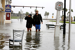 October 8, 2016 - St. Augustine, Florida, U.S. - DOUGLAS R. CLIFFORD   |   Times.Ayano Kleinschck, left, and Patrick Wall explore the historic district of St. Augustine on Friday (10/7/16) near the Castillo de San Marcos, the oldest masonry fort in the continental United States, background. The area became flooded as hurricane Matthew passed the historic city of St. Augustine on Florida's east coast. (Credit Image: © Douglas R. Clifford/Tampa Bay Times via ZUMA Wire)