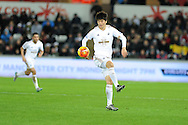 Ki Sung-Yueng of Swansea city in action.Barclays Premier league match, Swansea city v West Ham Utd at the Liberty Stadium in Swansea, South Wales  on Sunday 20th December 2015.<br /> pic by  Andrew Orchard, Andrew Orchard sports photography.