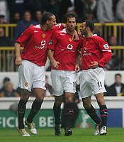 BARCLAYS PREMIERSHIP-25 SEPT-04-TOTTENHAM v M Utd -PIC BY KIERAN GALVIN / COLORSPORT-Ruud van Nistelrooy celebrate with Rio Ferdinand and Ryan Giggs.
