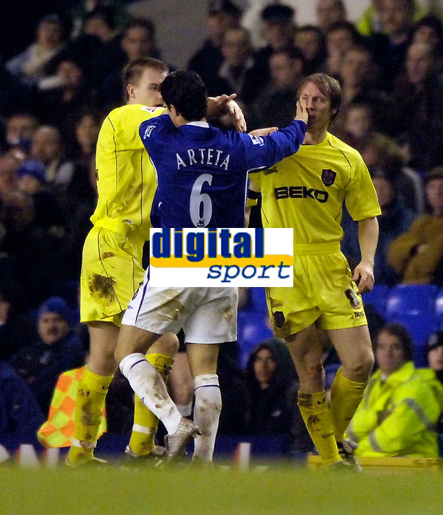 Photo: Jed Wee.<br /> Everton v Millwall. The FA Cup. 18/01/2006.<br /> <br /> Everton's Mikel Arteta gets himself in a skirmish with Millwall's Dave Livermore.