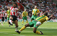 Photo: Lee Earle.<br /> Southampton v West Bromwich Albion. Coca Cola Championship. 12/08/2006. Saint's Alexander Ostlund (L) clears from Nathan Ellington.