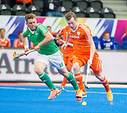The Netherlands Seve Van Ass  is watched by Shane O'Donoghue of Ireland. Ireland v The Netherlands - Semi-Final Unibet EuroHockey Championships, Lee Valley Hockey & Tennis Centre, London, UK on 27 August 2015. Photo: Simon Parker