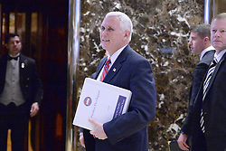 Vice President Elect Mike Pence talks to reporters in the lobby of the Trump Tower in New York, NY, on November 28, 2016. (Anthony Behar / Pool)