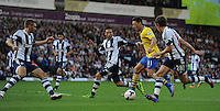 Arsenal's Mesut Ozil runs at the West Bromwich Albion defence watched by Morgan Amalfitano and Billy Jones (#28)<br /> <br /> Photo by Stephen White/CameraSport<br /> <br /> Football - Barclays Premiership - West Bromwich albion v Arsenal - Sunday 6th October 2013 - The Hawthorns - West Bromwich<br /> <br /> © CameraSport - 43 Linden Ave. Countesthorpe. Leicester. England. LE8 5PG - Tel: +44 (0) 116 277 4147 - admin@camerasport.com - www.camerasport.com