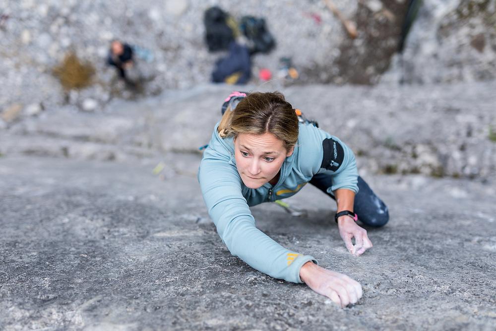 Sasha Digiulian climbing a 5.12a at Grotto Canyon in Canmore, Alberta