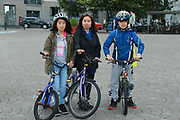 Dong Xia Zhahe with her children Michelle and Eddie at the opening of the Galway Bike Festival on Saturday. Photo:-XPOURE.IE / NO FEE
