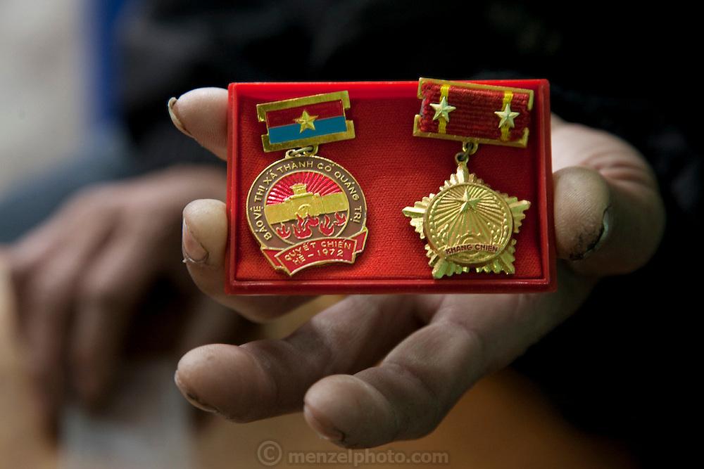 Vietnamese war veteran  Thuan Nguyen Van displays his medals in Hanoi, Vietnam. (Thuan Nguyen Van is featured in the book What I Eat: Around the World in 80 Diets.) MODEL RELEASED.