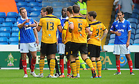 Portsmouth's Jed Wallace argues with Newport County's Andy Sandell after a late challenge<br /> <br /> Photographer Kevin Barnes/CameraSport<br /> <br /> Football - The Football League Sky Bet League Two - Portsmouth v Newport County AFC - Saturday 30th August 2014 - Fratton Park - Portsmouth<br /> <br /> © CameraSport - 43 Linden Ave. Countesthorpe. Leicester. England. LE8 5PG - Tel: +44 (0) 116 277 4147 - admin@camerasport.com - www.camerasport.com