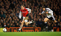 Fredrik Ljungberg (Arsenal) Stephen Clemence (Tottenham). Tottenham 1:1 Arsenal, FA Carling Premiership, 18/12/2000. Credit Colorsport / Stuart MacFarlane.