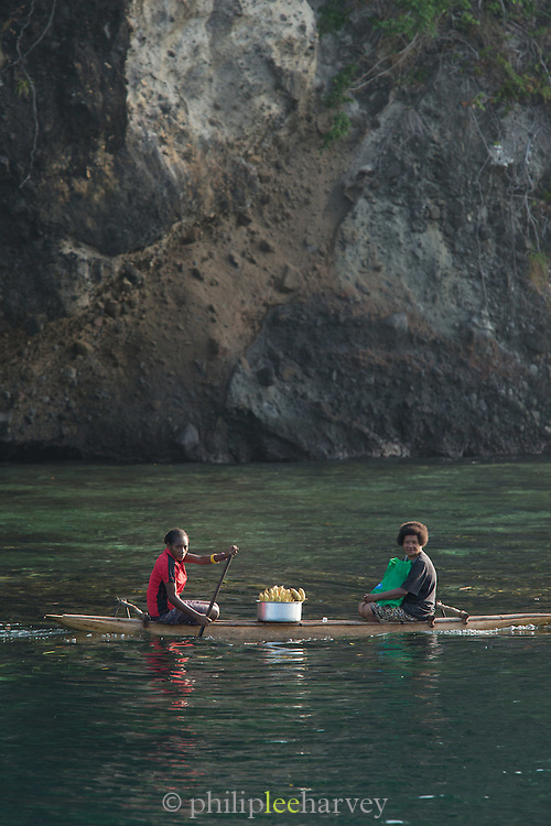 Women Canoe to market with bananas in the morning, Tufi, Cape Nelson, Oro Province, Papua New Guinea