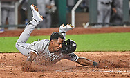 Chicago White Sox shortstop Tim Anderson (7) dives home to score a run against the Kansas City Royals during the sixth inning at Kauffman Stadium.