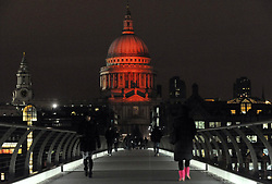 The dome of St Paul's Cathedral is lit up in red to mark World Aids Day in London.