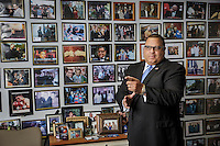 Louis Perry, founder and president of Kadima Security with some of his many photos showing his clientele in Encino, CA. Aug. 25 2016.  Photo /David Sprague