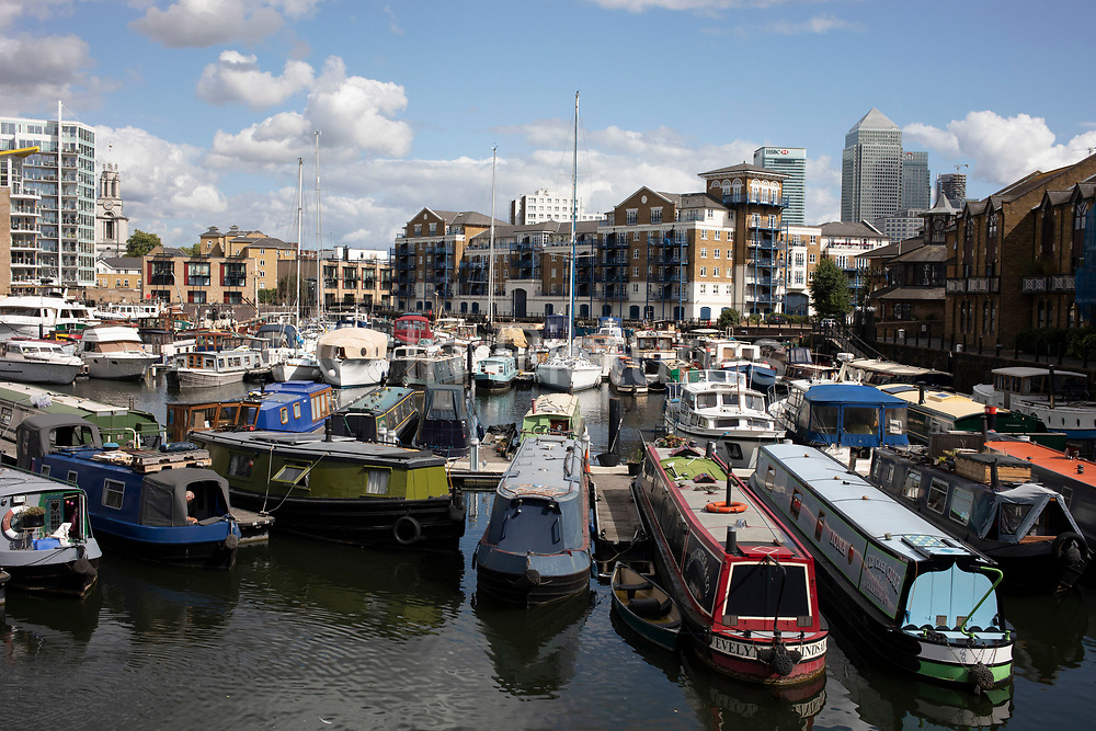 Boats, barges and narrowboats of all shapes, sizes and colours moored at Limehouse Basin in East London, England, United Kingdom. Limehouse Basin in Limehouse, in the London Borough of Tower Hamlets provides a navigable link between the Regents Canal and the River Thames, through the Limehouse Basin Lock.