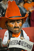 Nov 18, 2011; Ames, IA, USA; The Oklahoma State Cowboys mascot holds a sign about Brandon Weeden (not pictured) during the first half of a game against the Iowa State Cyclones at Jack Trice Stadium. Iowa State Cyclones defeated the Oklahoma State Cowboys 37-31. Mandatory Credit: Beth Hall-US PRESSWIRE Editorial sports photography of the Iowa State Cyclones vs. Oklahoma State Cowboys in 2011 in Aimes, Iowa.