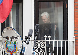 Julian Assange before speaks from the balcony of the Ecuadorian embassy in London after a seven-year investigation in Sweden against the WikiLeaks founder was suddenly dropped.