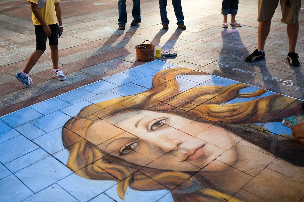 Pedestrians stop to admire artist Gabrielle Abbott's street painting of Botticelli's Venus on the Westlake Center Plaza in Seattle, Washington.