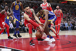 January 17, 2018 - Chicago, IL, USA - Chicago Bulls forward Denzel Valentine (45) and Golden State Warriors forward Kevon Looney (5) fight for possession of a lose ball during the second half at the United Center in Chicago on Wednesday, Jan. 17, 2018. The Warriors won, 119-112. (Credit Image: © Armando L. Sanchez/TNS via ZUMA Wire)