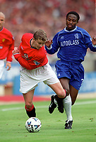Ole Gunnar Solskjaer (Man Utd) and Celestine Babayaro (Chelsea). Chelsea v Manchester United. FA Charity Shield. Wembley 13/8/00. Credit: Colorsport.