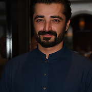 """Hamza Ali Abbasi  attend Photocall in London Premiere of """"Parwaaz Hai Junoon"""" (Soaring Passion) as featured on SKY, ITV at The May Fair Hotel, Stratton Street, London, UK. 22 August 2018."""