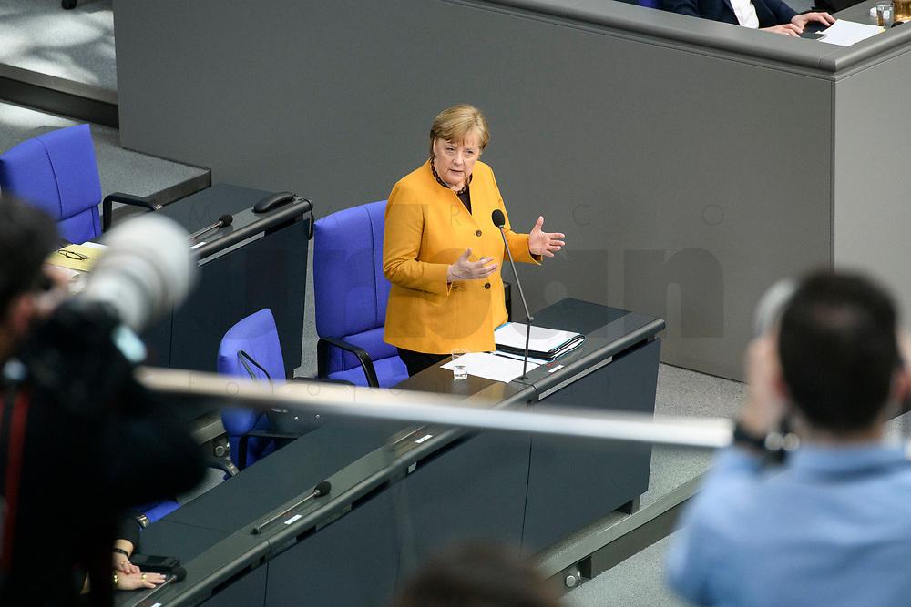 24 MAR 2021, BERLIN/GERMANY:<br /> Angela Merkel, CDU, Bundeskanzlerin, waehrend der Regierungsbefragung durch den Bundestag zur Bekaempfung der Corvid-19 Pandemie, Plenarsaal, Reichstagsgebaeude, Deutscher Bundestag<br /> IMAGE: 20210324-01-053<br /> KEYWORDS: Corona