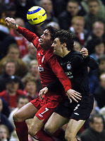 Photo: Javier Garcia/Back Page Images Mobile +447887 794393 Liverpool v Olimpiacos, UEFA Champions League 08/12/04, Anfield<br />A rejuvenated Harry Kewell gets to the ball ahead of Stylianos Venetidis