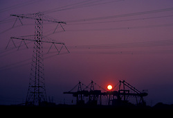 Stock photo of a sunset behind an electrical station