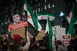 December 13, 2016 - London, London - London, UK. People gather opposite Downing Street, London, to protest the bombardment of the Syrian city of Aleppo and call for an immediate ceasefire to allow the evacuation of civilians and the delivery of humanitarian aid. Syrian government forces, supported by Russian and Iranian air strikes, are attempting to retake the rebel-held eastern districts of the city, containing tens of thousands of civilians. (Credit Image: © Rob Pinney/London News Pictures via ZUMA Wire)