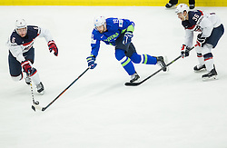 Ziga Pance of Slovenia between Mike Reilly of USA and Mark Arcobello of USA during Ice Hockey match between Slovenia and USA at Day 10 in Group B of 2015 IIHF World Championship, on May 10, 2015 in CEZ Arena, Ostrava, Czech Republic. Photo by Vid Ponikvar / Sportida