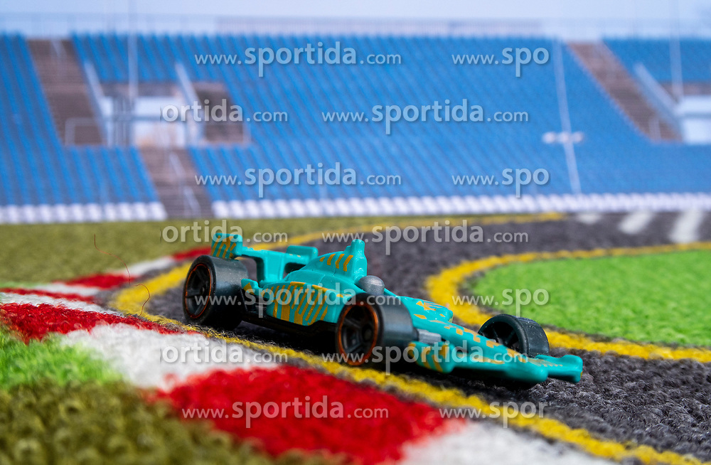 THEMENBILD - Ein Modell-Rennauto in einem Diorama auf einem Spielteppich mit Hintergründen vom Red Bull Ring in Spielberg, aufgenommen am 06.05.2020 in Graz // race car models in a diorama of the Red Bull Ring on 6 May 2020. EXPA Pictures © 2020, PhotoCredit: EXPA/ Erwin Scheriau