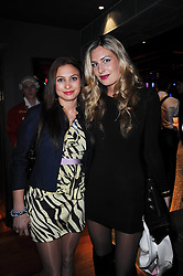 Left to right, sisters CLARY ASPINALL and TANSY ASPINALL at the Tatler Little Black Book Party held at Chinawhite, 4 Winsley Street, London on 20th November 2009.