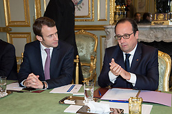 French President Francois Hollande flanked by Minister of Economy, Recovery of Productivity and Digital Affairs Emmanuel Macron meets with French oil industry group leaders to make sure that the drop of crude oil price has an impact on the price of gasoline, at the Elysee Palace in Paris, France on Monday, December 8, 2014. Photo Pool by Pierre Villard/ABACAPRESS.COM