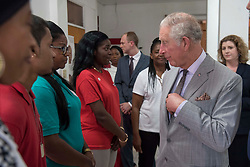 The Prince of Wales talks with staff and volunteers at the Red Cross, along with International Development Secretary Penny Mordaunt (right), during a visit to the island of Tortola in the British Virgin Islands as he continues his tour of hurricane-ravaged Caribbean islands.