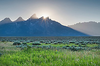 Setting sun behind the Teton Range from Antelope Flats. Grand Teton National Park
