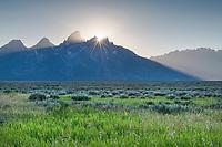 Setting sun behind the Teton Range from Antelope Flats. Grand Teton National Park