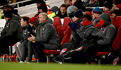 Arsenal manager Arsene Wenger (centre) in the dugout