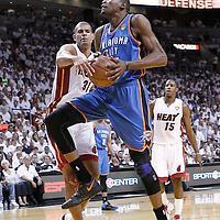 19 June 2012: Oklahoma City Thunder small forward Kevin Durant (35) goes for the layup past Miami Heat small forward Shane Battier (31) during the Miami Heat 104-98 victory over the Oklahoma City Thunder, in Game 4 of the 2012 NBA Finals, at the AmericanAirlinesArena, Miami, Florida, USA.