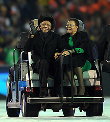 JOHANNESBURG, July 12, 2010  South African Former President Nelson Mandela (L) and his wife Graca Machel greet the spectators during the closing ceremony of the 2010 FIFA football World Cup ahead of the final between the Netherlands and Spain on July 11, 2010 at Soccer City stadium in Johannesburg, South Africa. (Xinhua/Wang Yuguo) (Credit Image: © Xinhua via ZUMA Wire)