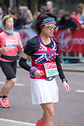 A female runner on Birdcage Walk during The Virgin London Marathon on 28th April 2019 in London in the United Kingdom. Now in it's 39th year, the London Marathon is a large sporting event with over 40,000 runners expected to take part.