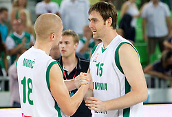 Edo Muric of Slovenia and Erazem Lorbek of Slovenia after the friendly match before Eurobasket Lithuania 2011 between National teams of Slovenia and Lithuania, on August 24, 2011, in Arena Stozice, Ljubljana, Slovenia. Slovenia defeated Lithuania 88-66. (Photo by Vid Ponikvar / Sportida)